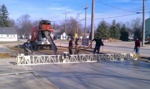 Concrete-construction-equipment-parking lot-pole barn